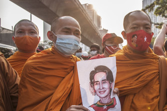 Thai monks hold a portrait of Aung San Suu Kyi during a demonstration outside the Burmese embassy in Bangkok.