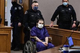 Ahmad Al Aliwi Alissa, 21, appears in a Boulder court in a wheelchair.