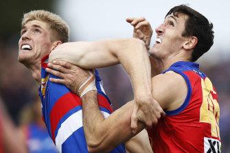 Bulldog Tim English battles with Lion Oscar McInerney.