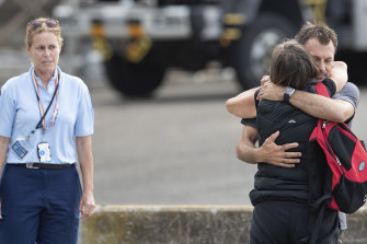 Family members of the victims of the White Island disaster returned to shore after marking a minute's silence on board a ship near the island on Monday.
