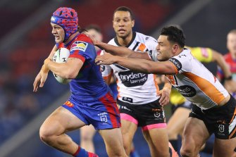 Kalyn Ponga shows the Tigers a clean pair of heels.