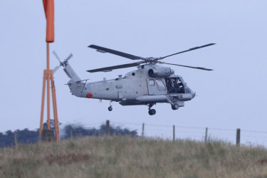 A helicopter takes off from Whakatane Airport as the mission to return victims of the White Island eruption begins.