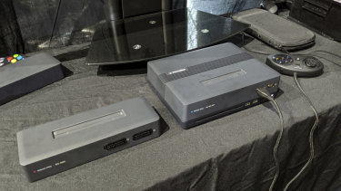 On the right, the Polymega base with the Mega Drive / Genesis / 32X module inserted. On the left, the Super Nintendo / Super Famicom module.