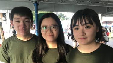 Edwin Mak, 23, and Michelle Shek, 19, right, performed a dramatisation of the Tiananmen Square crackdown for commuters at a Hong Kong ferry terminal on the evening of June 3.