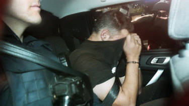 Jonathan Dick arrives at police headquarters on Monday.