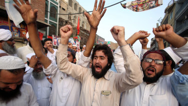 Supporters of different political parties demonstrate to reject the election results in Peshawar, Pakistan, on Friday.