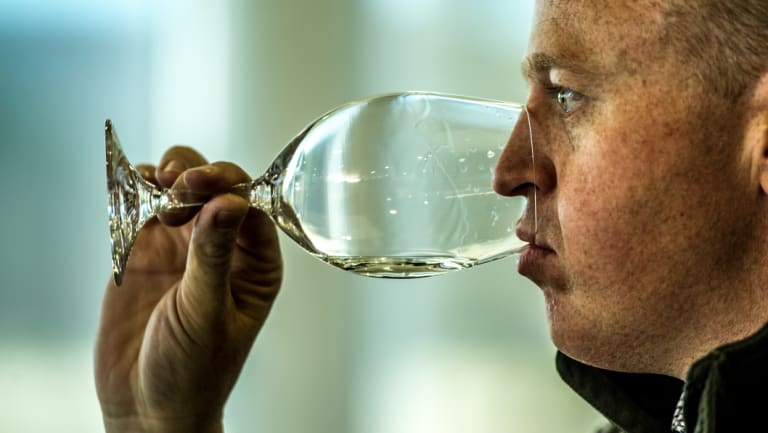 Judge, and local winemaker, Chris Carpenter samples a wine.