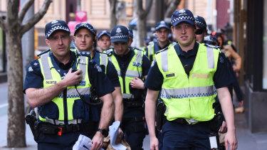 Police gather outside the Sofitel Hotel on Friday.
