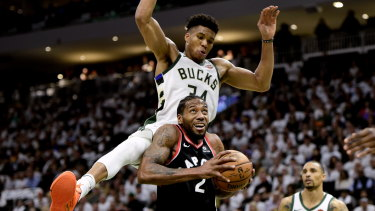 Toronto's Kawhi Leonard is fouled by Bucks superstar Giannis Antetokounmpo.