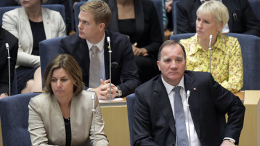 Stefan Lofven (bottom right) attends parliament during a vote of confidence in the Swedish Parliament Riksdagen.