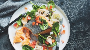 Baked salmon with mushrooms and spinach.