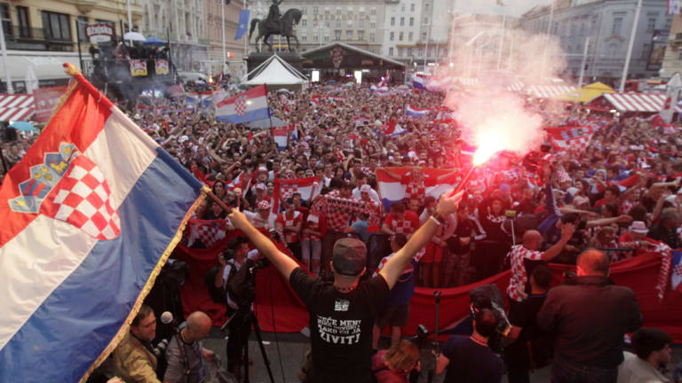 National fervour: Croatian fans watch their team win the semi-final against England in Zagreb.