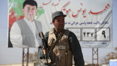 Afghan police stand guard at a checkpoint ahead of parliamentary elections scheduled for October 20.
