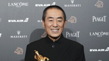 "Chinese director Zhang Yimou holds his award for Best Director at the 55th Golden Horse Awards in Taipei, Taiwan. The latest film from Zhang has been dropped from the Berlin International Film Festival for ""technical reasons."""