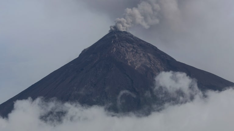 A plume of smoke and ash rise from the Volcano of Fire as seen from San Miguel Los Lotes, Guatemala, in June.