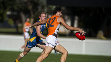 Quantum leap: Giant Jack Stein takes a shot in goal in the NEAFL competition.