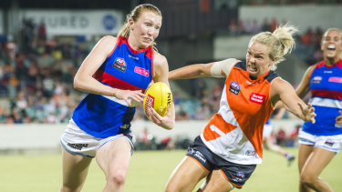 Phoebe McWilliams, in GWS colours, gives chase on Tiarna Ernst of the Bulldogs last season.