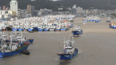 Fishing boats are docked at the Shenjiamen Fishing Port in Zhoushan city, China, in preparation for the typhoon Lekima.