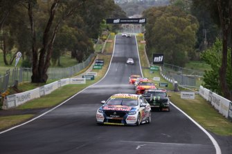 Shane van Gisbergen leads the field down Conrod Straight at Mount Panorama earlier this year.