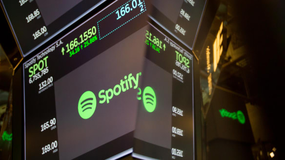 Spotify stock surges as it makes Wall Street debut