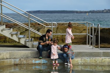 Gena Been (2nd from left) and Tony Been (right) with their daughters Winona Been 5yrs (left) and Daisy Been aged 2yrs (2nd from right) at the children's pool at Bondi Beach, Sydney. 22nd June, 2021. Photo: Kate Geraghty