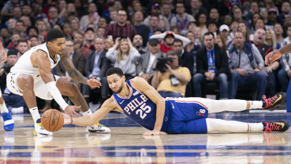 Sixers hold off Nuggets to extend home run
