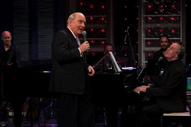 Repeat offender: Alan Jones is not shy of the stage, seen here singing on Simon Burke's Studio A show back in 2006.
