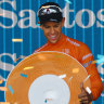 Richie Porte celebrates on the podium after winning the overall title after stage six of the Tour Down Under.