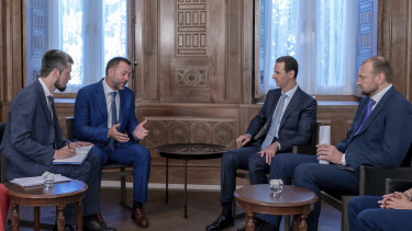 Syrian President Bashar al-Assad, second right, meets with a Russian delegation in Damascus on Tuesday. His forces are supported by Russia.