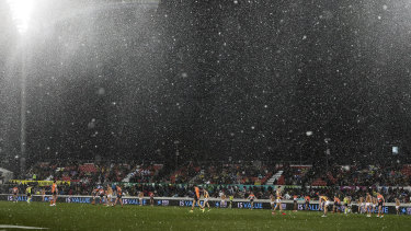 It's believed to be the first time snow has fallen during an AFL game.