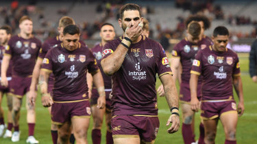 Greg Inglis of the Maroons leads his players from the ground after defeat in Origin I.