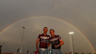 Tom and Jake Trbojevic enjoy the light show after the match at Glen Willow Sporting Complex on Saturday.