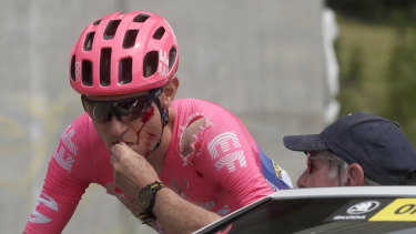 Doctor to you: Tejay Van Garderen gets assistance from the medical car after a fall.