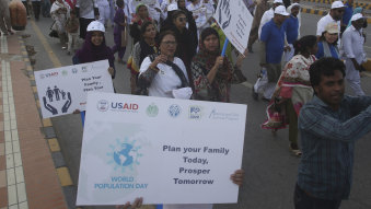 Pakistani activists take part in a World Population Day walk last month.