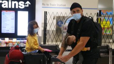 Sonny Bill Williams returns to Australia at Sydney Airport.