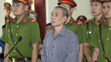Activist Le Dinh Luong stands trial in central province of Nghe An, Vietnam.