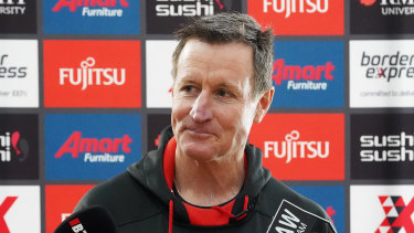 Essendon coach John Worsfold speaks to the media ahead of training on Wednesday.