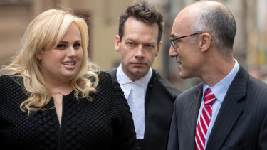 Rebel Wilson with her legal team in her defamation case against Woman's Day, including barrister Matthew Collins, QC (centre).