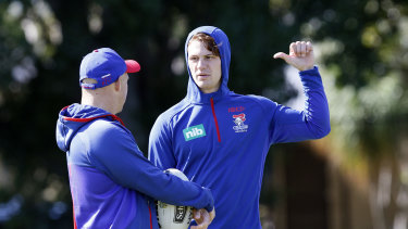 Positional switch: Kalyn Ponga talks with Newcastle coach Nathan Brown.