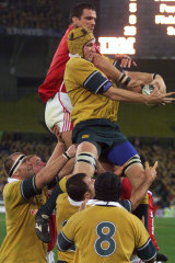 Harrison grabs the key ball from the Lions Martin Johnson in 2001 to clinch the series.