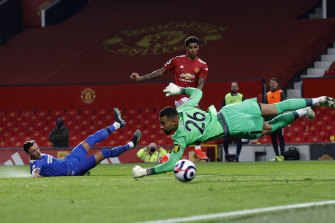 Marcus Rashford scores for United despite Robert Sanchez's best efforts to keep the ball out of the net.