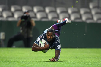 Hat-trick hero: Suliasi Vunivalu scores one of his three tries at Netstrata Jubilee Stadium.