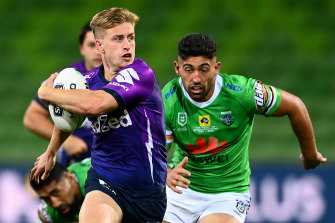 Cameron Munster, left, in action against the Raiders during round three at AAMI Park.