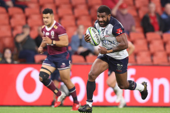 Marika Koroibete charges ahead for the Rebels.