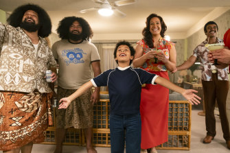 Ten-year-old Dwayne Johnson (Adrian Groulx) with the Wild Samoans (John Tui and Fasi Amosa, mother Ata (Stacey Leilua) and father Rocky (Joseph Lee Anderson) in Young Rock.
