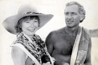 Federal MP Andrew Peacock and film star Shirley Maclaine strolling on a beach in 1982.