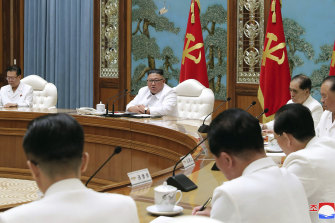 North Korean leader Kim Jong-un, centre, attends an emergency Politburo meeting in Pyongyang last month.