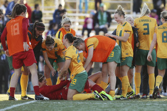 Australian teammates congratulate goalkeeper Brianna Davey after success in a penalty shootout.