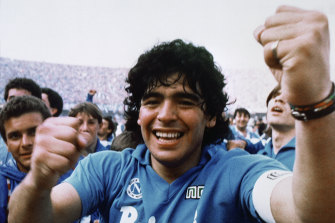 Maradona cheers after the Napoli team clinched their first Serie A title in 1987.