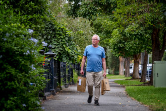 The retail term 'foot traffic' takes on new meaning for the Avenue Bookstore's Chris Redfern as he delivers books to customers' homes.